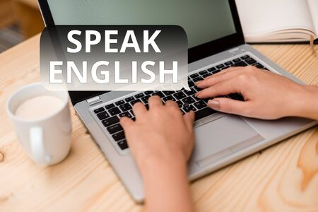 Text sign showing Speak English. Business photo showcasing Study another Foreign Language Online Verbal Courses woman laptop computer smartphone mug office supplies technological devices