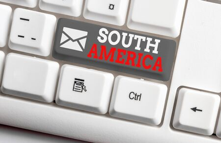 Conceptual hand writing showing South America. Concept meaning Continent in Western Hemisphere Latinos known for Carnivals White pc keyboard with note paper above the white background