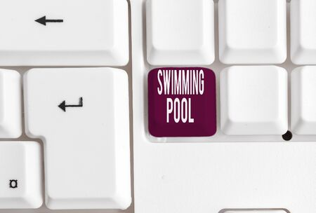 Writing note showing Swimming Pool. Business concept for Structure designed to hold water for leisure activities White pc keyboard with note paper above the white background