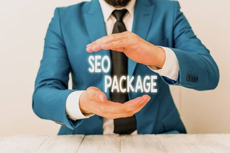 Writing note showing Seo Package. Business concept for practice of search engine optimization increase amount visitors Man holds empty paper with copy space in front of him Space