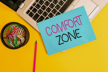Word writing text Comfort Zone. Business photo showcasing A situation where one feels safe or at ease have Control Trendy metallic laptop small paper sheet pencil clips colored background Фото со стока