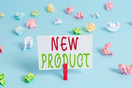 Conceptual hand writing showing New Product. Concept meaning goods and services that differ in their characteristics Colored clothespin rectangle shaped paper blue background Фото со стока