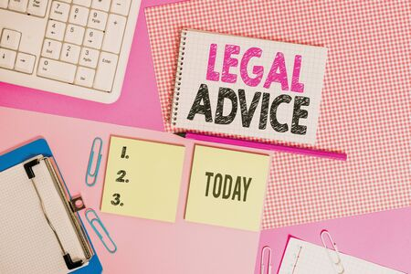 Text sign showing Legal Advice. Business photo text Lawyer opinion about law procedure in a particular situation Writing equipments and computer stuffs placed above colored plain table