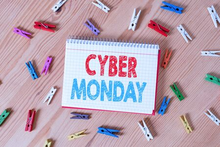 Conceptual hand writing showing Cyber Monday. Concept meaning Marketing term for Monday after thanksgiving holiday in the US Colored crumpled papers wooden floor background clothespin Фото со стока