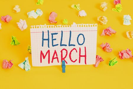 Word writing text Hello March. Business photo showcasing musical composition usually in duple or quadruple with beat Colored crumpled papers empty reminder white floor background clothespin