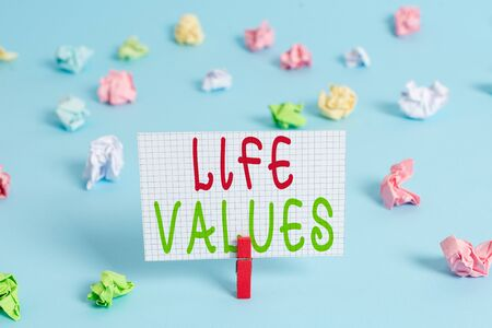Conceptual hand writing showing Life Values. Concept meaning things that you believe are important in the way you live Colored clothespin rectangle shaped paper blue background