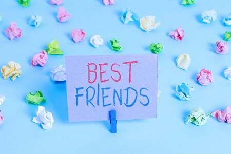 Word writing text Best Friends. Business photo showcasing A demonstrating you value above other demonstratings Forever buddies Colored crumpled papers empty reminder blue floor background clothespin