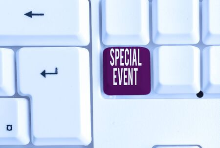 Writing note showing Special Event. Business concept for Function to generate money for non profit a Crowded Occassion White pc keyboard with note paper above the white background 写真素材
