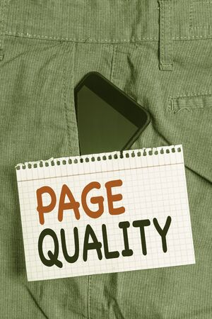 Handwriting text Page Quality. Conceptual photo Effectiveness of a website in terms of appearance and function Smartphone device inside formal work trousers front pocket near note paper