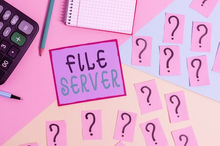 Handwriting text File Server. Conceptual photo device which controls access to separately stored data Mathematics stuff and writing equipment above pastel colours background