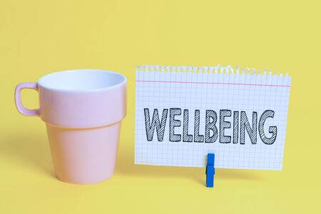 Writing note showing Wellbeing. Business concept for A good or satisfactory condition of existence including health Cup empty paper blue clothespin rectangle shaped reminder yellow office Reklamní fotografie