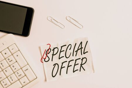 Text sign showing Special Offer. Business photo showcasing Discounted price Markdown Promotional Items Crazy Sale White pc keyboard with empty note paper above white background and mobile phone