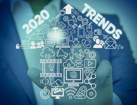 Writing note showing 2020 Trends. Business concept for things that is famous for short period of time in current year Male wear formal work suit presenting presentation smart device