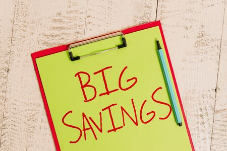 Handwriting text Big Savings. Conceptual photo income not spent or deferred consumption putting money aside Colored clipboard blank paper sheet marker old wooden vintage background