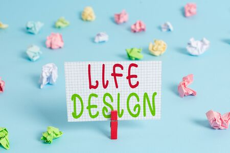 Conceptual hand writing showing Life Design. Concept meaning balance how you live between work family and entertaining Colored clothespin rectangle shaped paper blue background