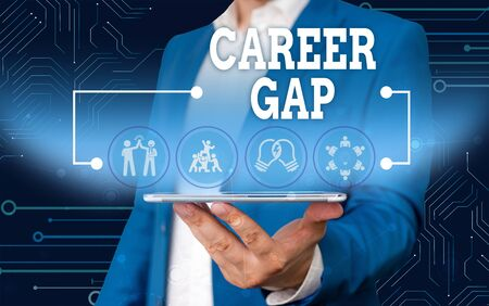 Conceptual hand writing showing Career Gap. Concept meaning A scene where in you stop working by your profession for a while Male wear formal work suit presenting presentation smart device
