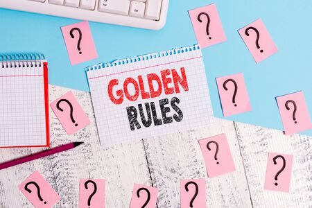 Text sign showing Golden Rules. Business photo showcasing Basic principle that should be followed Important Principle Writing tools, computer stuff and math book sheet on top of wooden table
