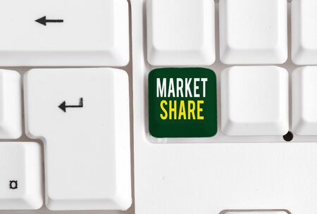 Conceptual hand writing showing Market Share. Concept meaning The portion of a market controlled by a particular company White pc keyboard with note paper above the white background