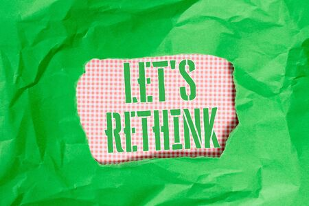 Text sign showing Let S Rethink. Business photo showcasing an Afterthought To Remember Reconsider Reevaluate Green crumpled ripped colored paper sheet centre torn colorful background