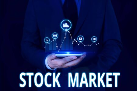 Text sign showing Stock Market. Business photo showcasing Particular market where stocks and bonds are traded or exhange Male human wear formal work suit presenting presentation using smart device