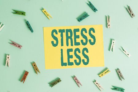 Handwriting text Stress Less. Conceptual photo Stay away from problems Go out Unwind Meditate Indulge Oneself Colored clothespin rectangle shaped reminder paper light blue background