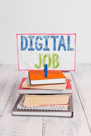 Word writing text Digital Job. Business photo showcasing get paid task done through internet and demonstratingal computer pile stacked books notebook pin clothespin colored reminder white wooden Фото со стока