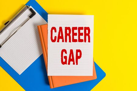 Word writing text Career Gap. Business photo showcasing A scene where in you stop working by your profession for a while Pile of empty papers with copy space on the table