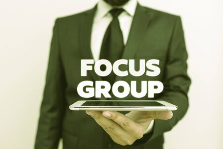 Writing note showing Focus Group. Business concept for showing assembled to participate in discussion about something Stock Photo