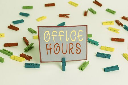 Conceptual hand writing showing Office Hours. Concept meaning The hours which business is normally conducted Working time Colored clothespin papers empty reminder white floor office Фото со стока