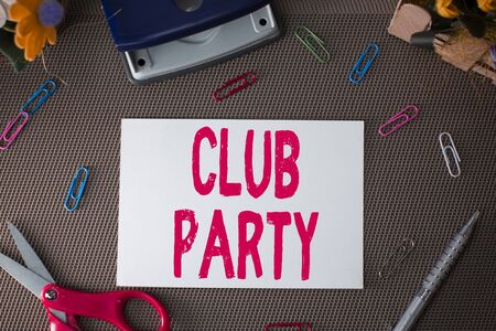 Handwriting text Club Party. Conceptual photo social gathering in a place that is informal and can have drinks Scissors and writing equipments plus plain sheet above textured backdrop Foto de archivo - 130158362