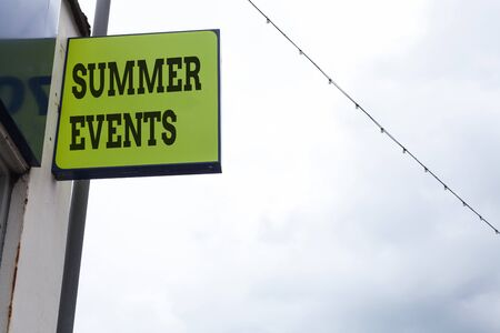 Word writing text Summer Events. Business photo showcasing Celebration Events that takes place during summertime Green ad board on the street with copy space for advertisement Foto de archivo - 130158295