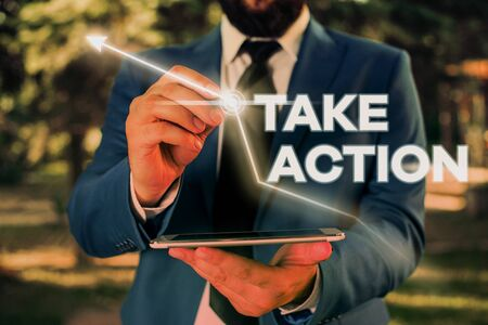 Writing note showing Take Action. Business concept for advices someone to do something or reaction right now