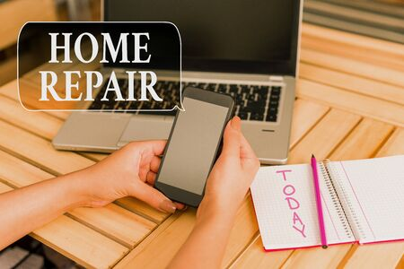 Word writing text Home Repair. Business photo showcasing maintenance or improving your own house by yourself using tools woman laptop computer smartphone office supplies technological devices