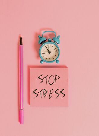 Text sign showing Stop Stress. Business photo text Seek help Take medicines Spend time with loveones Get more sleep Metal vintage alarm clock wakeup blank notepad marker colored background Stock fotó
