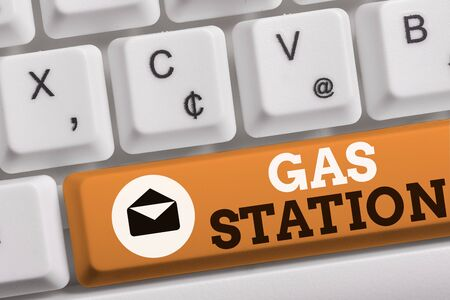Word writing text Gas Station. Business photo showcasing for servicing motor vehicles especially with gasoline and oil White pc keyboard with empty note paper above white background key copy space
