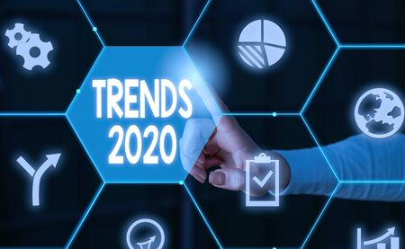 Word writing text Trends 2020. Business photo showcasing Upcoming year prevailing tendency Widely Discussed Online Male human wear formal work suit presenting presentation using smart device