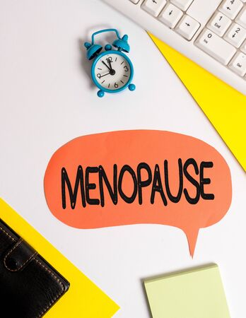 Word writing text Menopause. Business photo showcasing Period of peranalysisent cessation or end of menstruation cycle Flat lay with copy space on bubble paper clock and paper clips