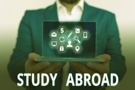 Conceptual hand writing showing Study Abroad. Concept meaning Pursuing educational opportunities in a foreign country