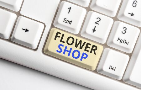 Text sign showing Flower Shop. Business photo showcasing where cut flowers are sold with decorations for gifts White pc keyboard with empty note paper above white background key copy space