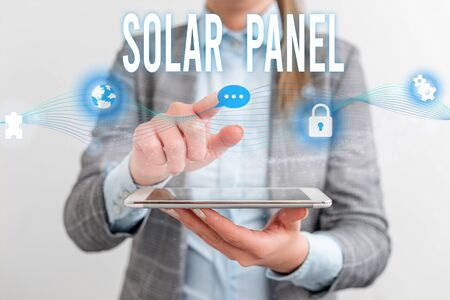 Handwriting text Solar Panel. Conceptual photo designed to absorb suns rays source of energy generating Female human wear formal work suit presenting presentation use smart device