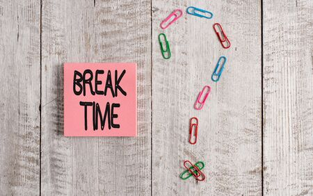 Writing note showing Break Time. Business concept for Period of rest or recreation after doing of certain work Pastel colour note paper placed next to stationary above wooden table