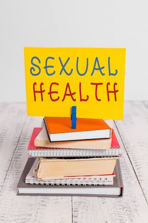 Conceptual hand writing showing Sexual Health. Concept meaning Healthier body Satisfying Sexual life Positive relationships pile stacked books notebook pin color reminder white wooden Фото со стока