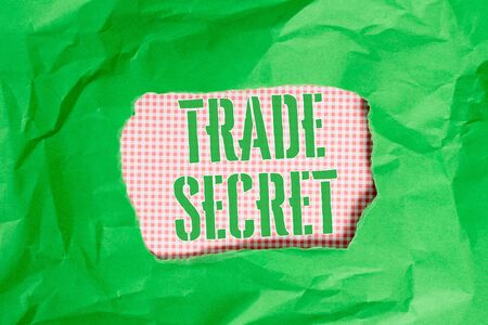 Text sign showing Trade Secret. Business photo showcasing Confidential information about a product Intellectual property Green crumpled ripped colored paper sheet centre torn colorful background