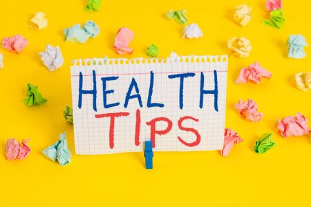 Word writing text Health Tips. Business photo showcasing state of complete physical mental and social well being Colored crumpled papers empty reminder white floor background clothespin