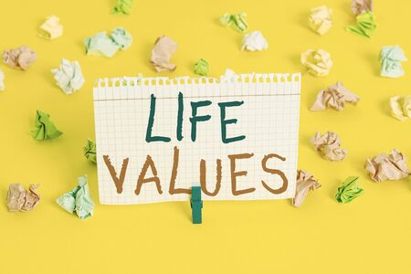 Word writing text Life Values. Business photo showcasing things that you believe are important in the way you live Colored crumpled papers empty reminder white floor background clothespin