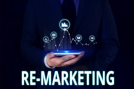 Text sign showing Re Marketing. Business photo showcasing Strategy to reach potential customers in your website Male human wear formal work suit presenting presentation using smart device Stok Fotoğraf