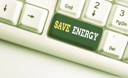 Conceptual hand writing showing Save Energy. Concept meaning decreasing the amount of power used achieving a similar outcome White pc keyboard with note paper above the white background