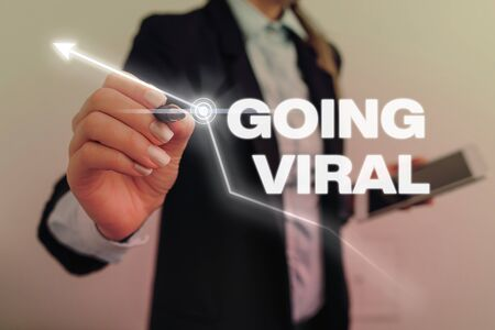 Text sign showing Going Viral. Business photo text image video or link that spreads rapidly through population Stock Photo