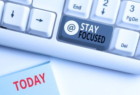 Word writing text Stay Focused. Business photo showcasing Be attentive Concentrate Prioritize the task Avoid distractions White pc keyboard with empty note paper above white background key copy space Stock Photo