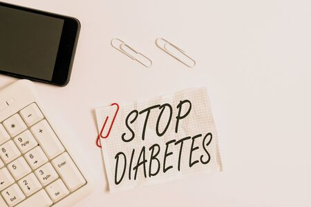 Text sign showing Stop Diabetes. Business photo showcasing Blood Sugar Level is higher than normal Inject Insulin White pc keyboard with empty note paper above white background and mobile phone Stock fotó